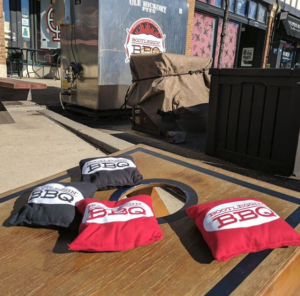 Cornhole - Play Bags on the Patio at Bootleggin BBQ St. Louis Downtown West Washington Avenue